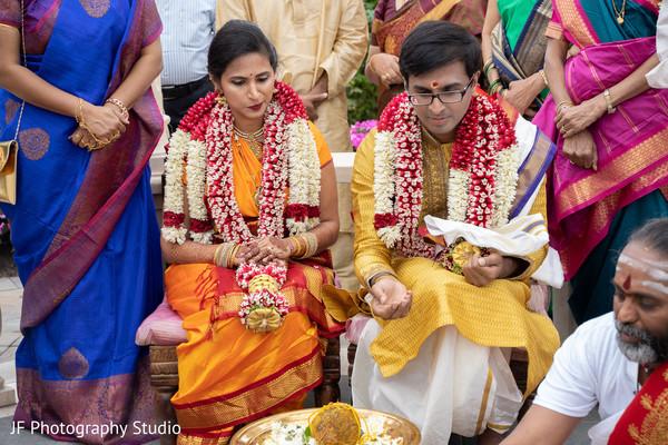 Maharani and rajah during wedding ritual capture.