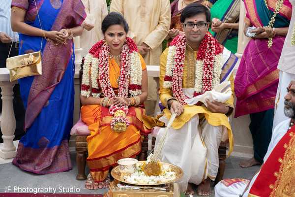 Indian bride and groom at the coconut ritual.