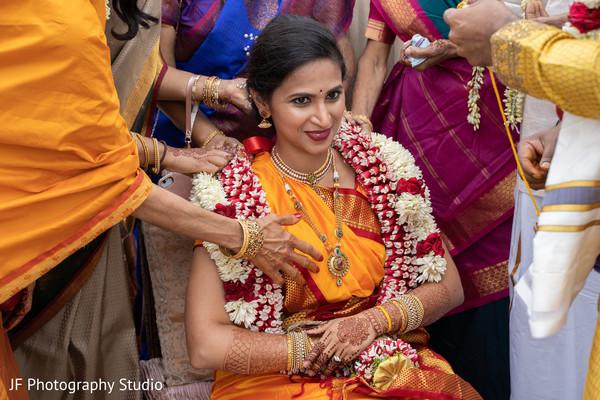 Stunning Indian bride at her wedding ritual.