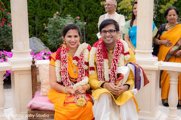 Joyful Indian bride and groom photo at ceremony.