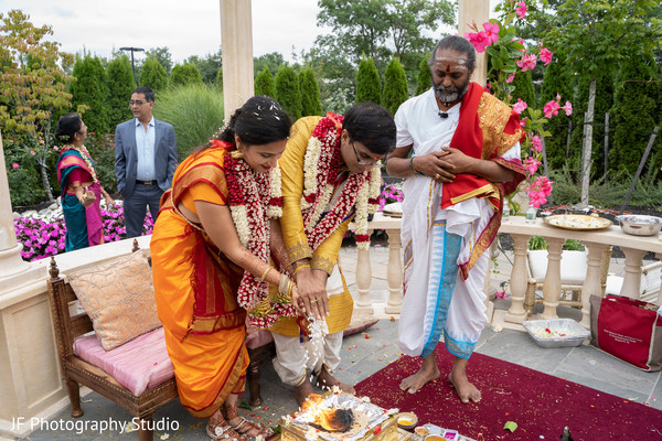 See this Indian wedding ritual of pouring rice to sacred fire.