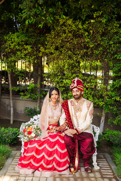 Dazzling shot of Indian bride and groom outdoors