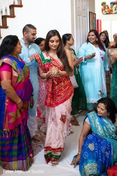Maharani holding the coconut photo.