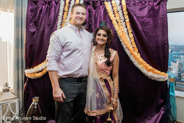 Indian couple at sangeet party photo.
