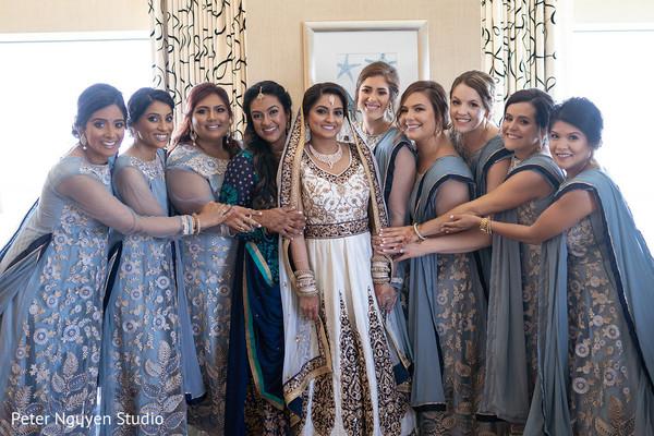 Joyful indian bride and  bridesmaids capture.