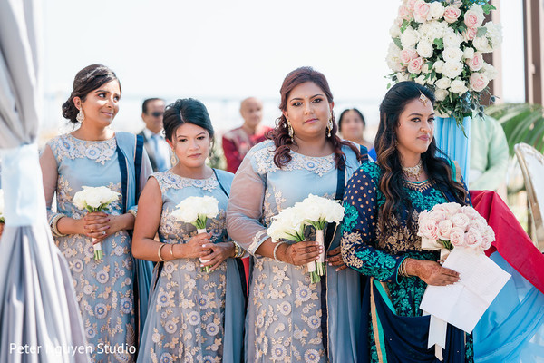 Lovely Indian bridesmaids at ceremony capture.
