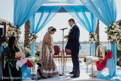 Indian groom saying his bows to bride.