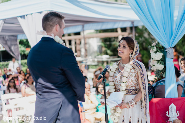 Lovely Indian couple at their wedding vows.