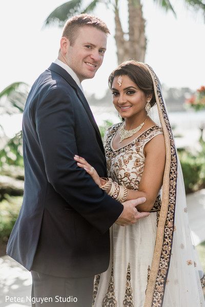 Ravishing Indian bride and groom  posing outdoors.