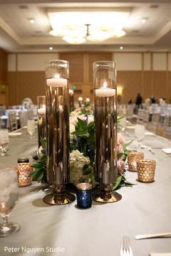 Elegant Indian wedding reception table candle holders.