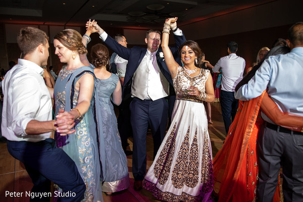 Upbeat indian wedding reception celebration.