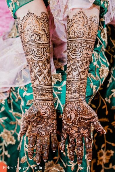 Indian bride showing her henna art capture.