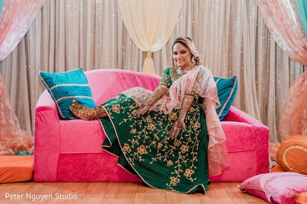 Enchanting Indian bride posing with her mehndi art.