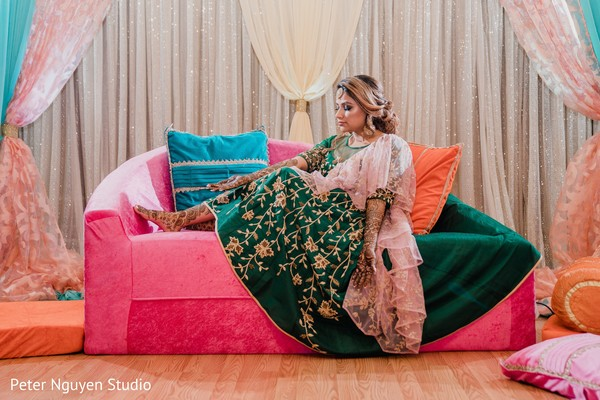 Elegant Indian bride on her mehndi outfit capture.