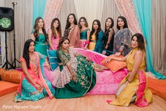 Indian bride and bridesmaids posing for a photo shoot.
