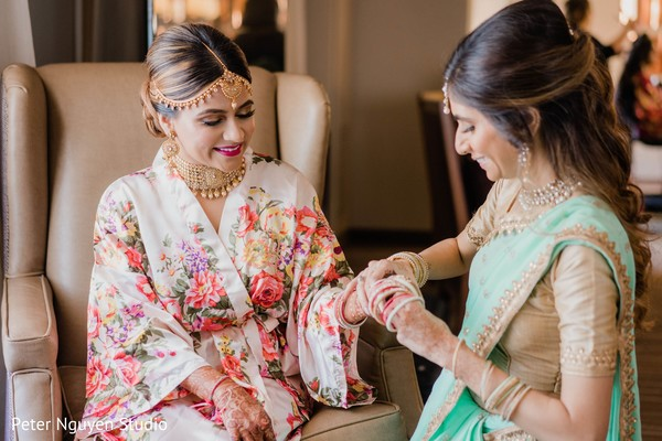 Enchanting Indian bride getting her ceremony jewelry on.