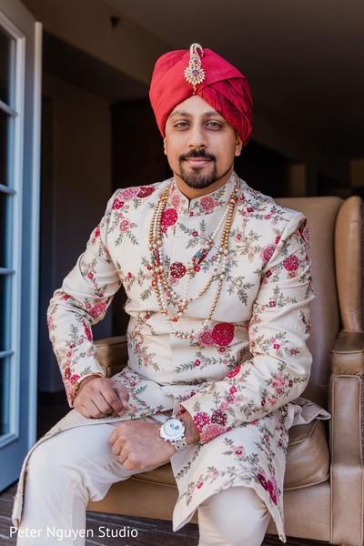 Majestic Indian groom on his sherwani,  turban, and jewelry.