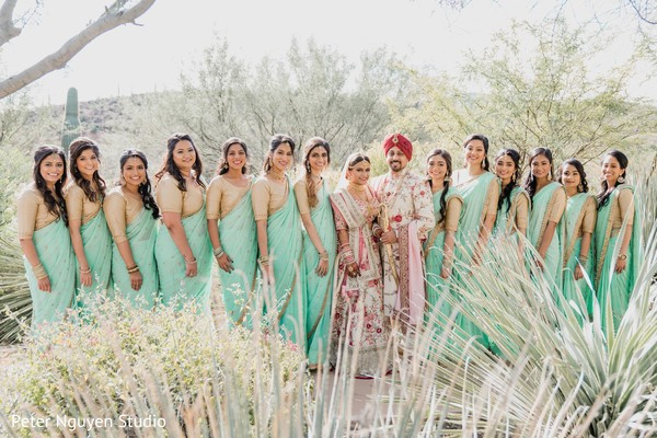 Indian couple with bridesmaids photo.