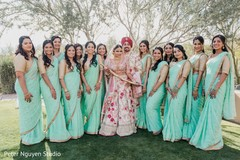 Happy Indian couple with bridesmaids capture.