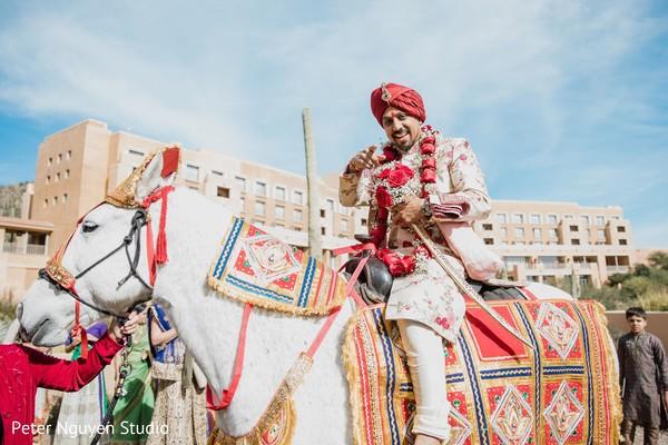 Enchanting Indian groom on his baraat horse photo.