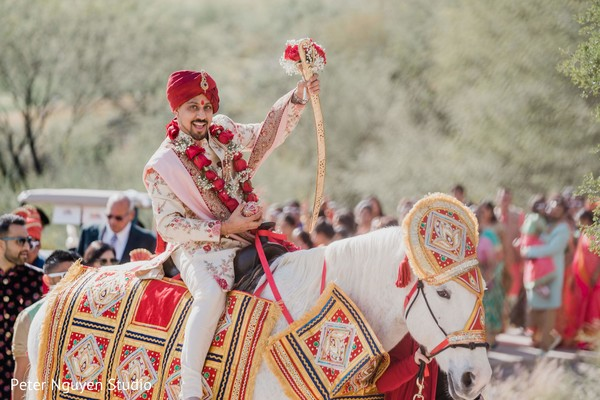 Cheerful Indian groom at his baraat outdoors photography.