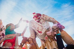 Maharani putting baraat garland to groom.