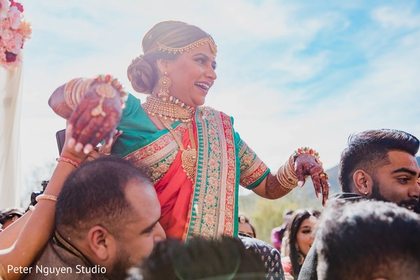 Enchanting Indian bride at baraat capture.