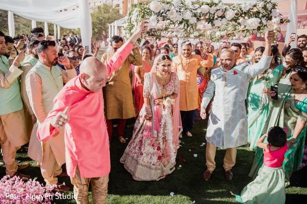 Enchanting Indian bride walking in to her wedding ceremony.
