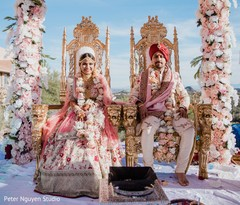 Maharani and Rajah at their wedding ceremony seats portrait.