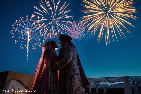 Delightful indian couple next to wedding fireworks  photo.