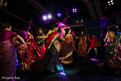 Beautiful Indian guests performing a choreography at the reception