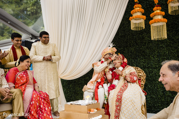 Indian bride and groom during the ravishing ceremony