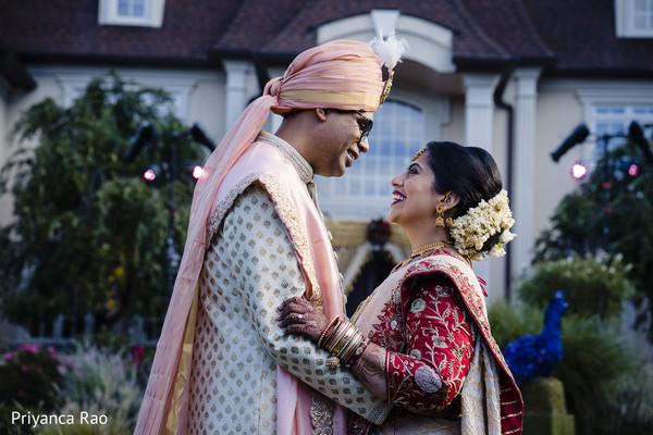 Indian groom and Maharani hugging