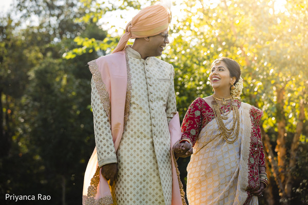 Joyful Indian bride and groom taking pictures