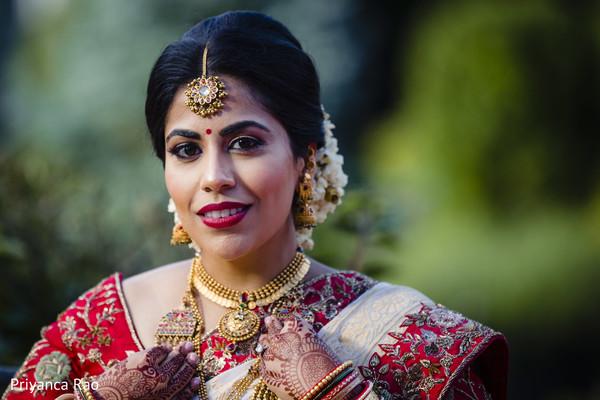Stunning Indian bride outdoors posing