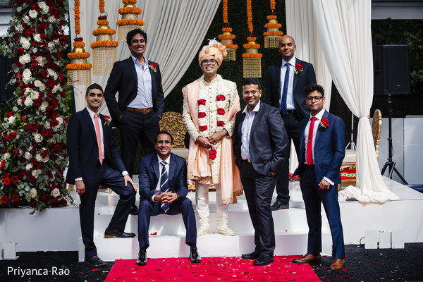 Indian groom posing with groomsmen at the venue