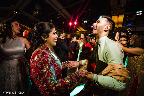 Indian bride having a blast at the reception