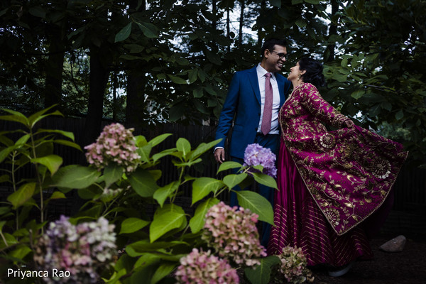 Indian couple posing outdoors prior to the reception