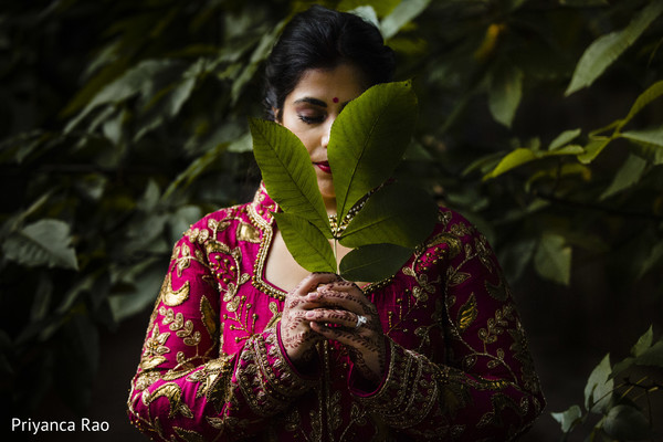 Indian bride posing with a leaf