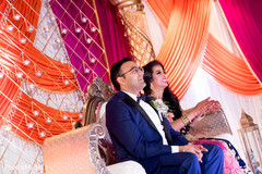 Indian bride and groom enjoying their reception.