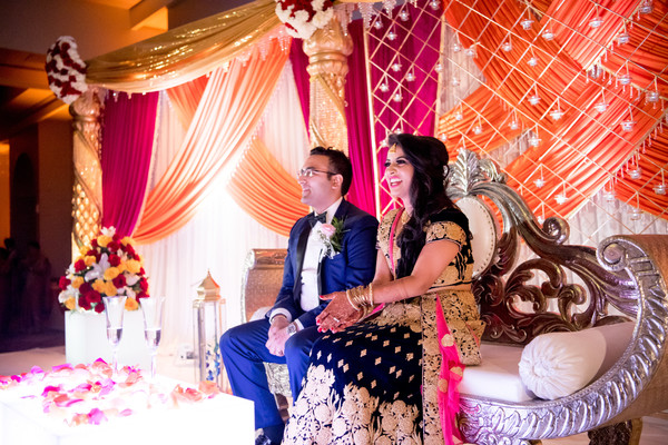 Lighthearted Indian bride and groom capture.