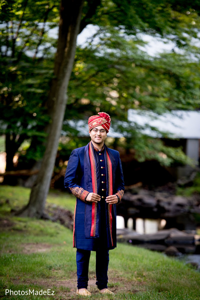 Charming Indian groom outdoors capture.