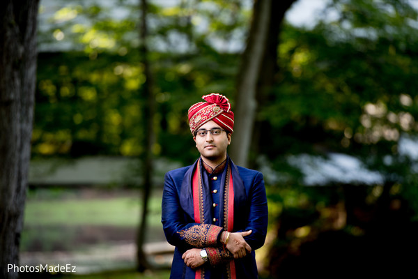 Gorgeous Indian groom on his ceremony attire.