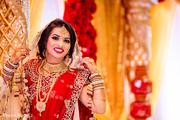 Ravishing Indian bride in her ceremony attire capture.