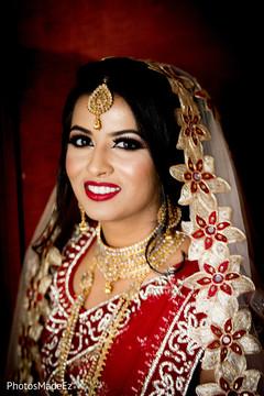 Dreamful capture of Indian bride on her ceremony dress.