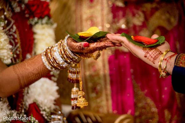 Maharani and rajah holding the leafs ritual.