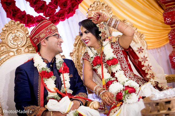 Indian couple holding during wedding ceremony ritual.