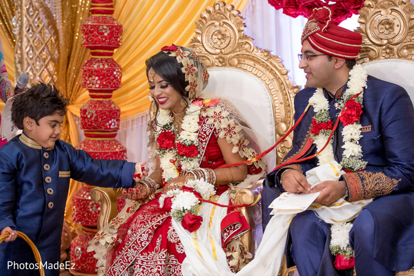 Indian bride getting petals from pageboy capture.