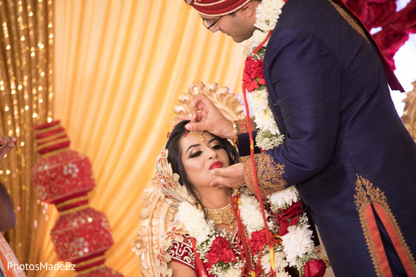 Maharani getting the Pithi red mark on her forehead.