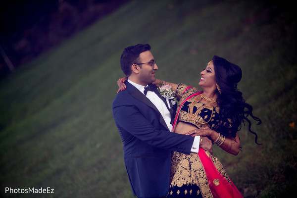 Joyful Indian bride and groom photo.